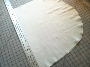 Next, the veil was folded in half and cut into two half ovals.