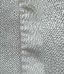 The veil strip is hand sewn with a running stitch.