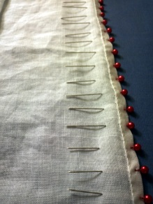 After the base veil was hemmed, I used pins to mark the locations for ruffle attachment.