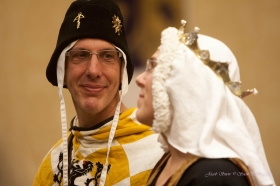 My husband, Gerald de Huntington, kneels with me during the Twelfth Night court.